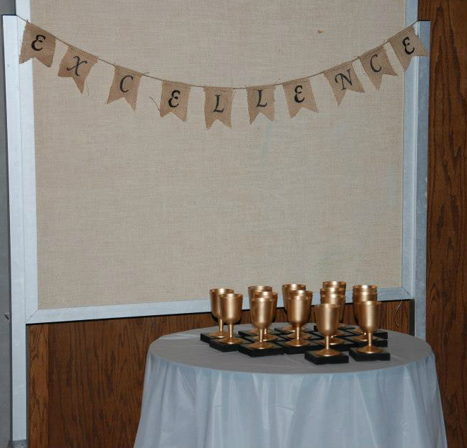 Young Women in Excellence red carpet theme | Young Women in Excellence Program by popular Utah lifestyle blogger, Kara Metta: image of DIY gold trophies and a pennant banner.