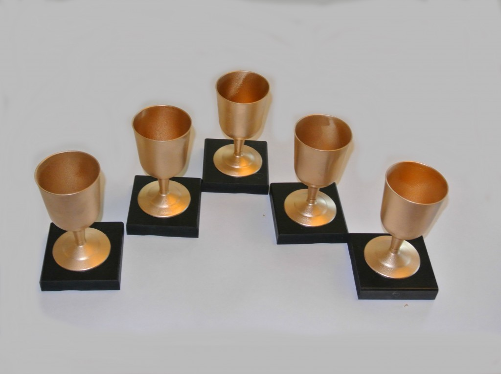 Young Women in Excellence red carpet theme | Young Women in Excellence Program by popular Utah lifestyle blogger, Kara Metta: image of DIY gold trophies.