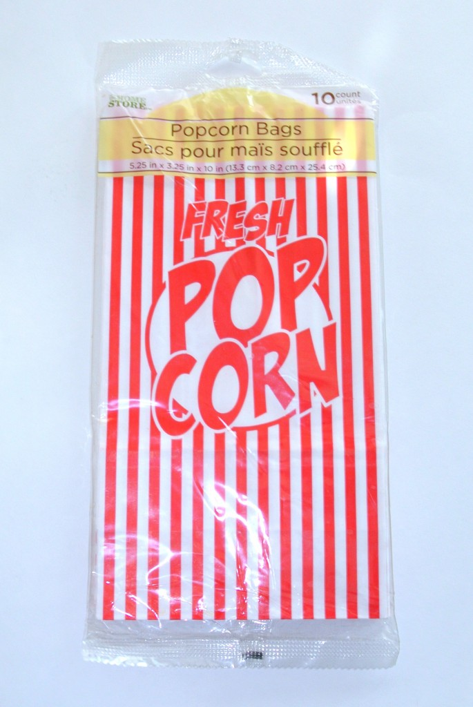 Young Women in Excellence red carpet theme | Young Women in Excellence Program by popular Utah lifestyle blogger, Kara Metta: image of red and white stripe popcorn bags.