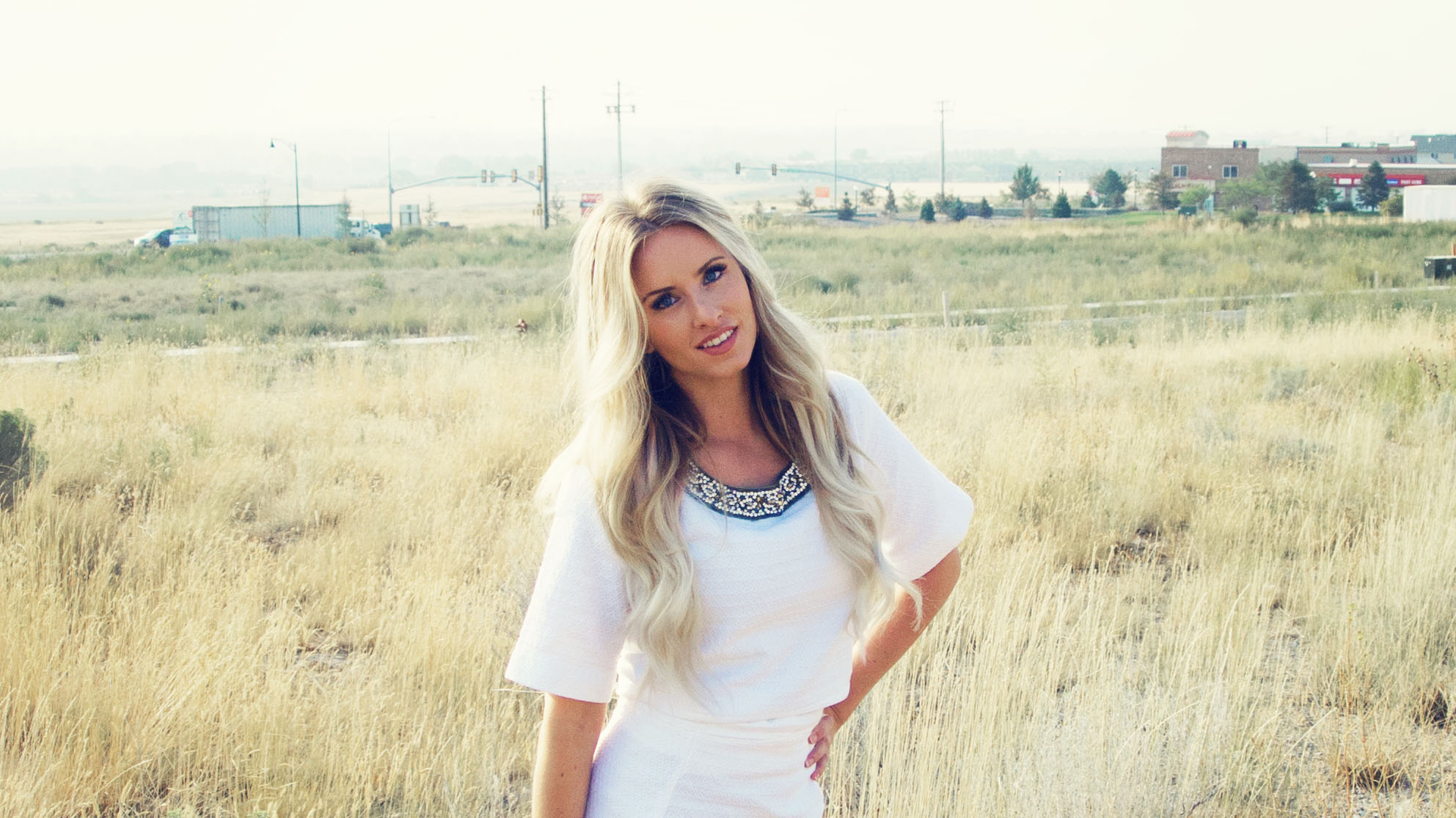 Glam Seamless Clip-in Hair Extension Review | Glam Seamless Hair Extensions Review by popular Utah beauty blogger, Kara Metta: image of a woman wearing Glam Seamless Hair Extensions.