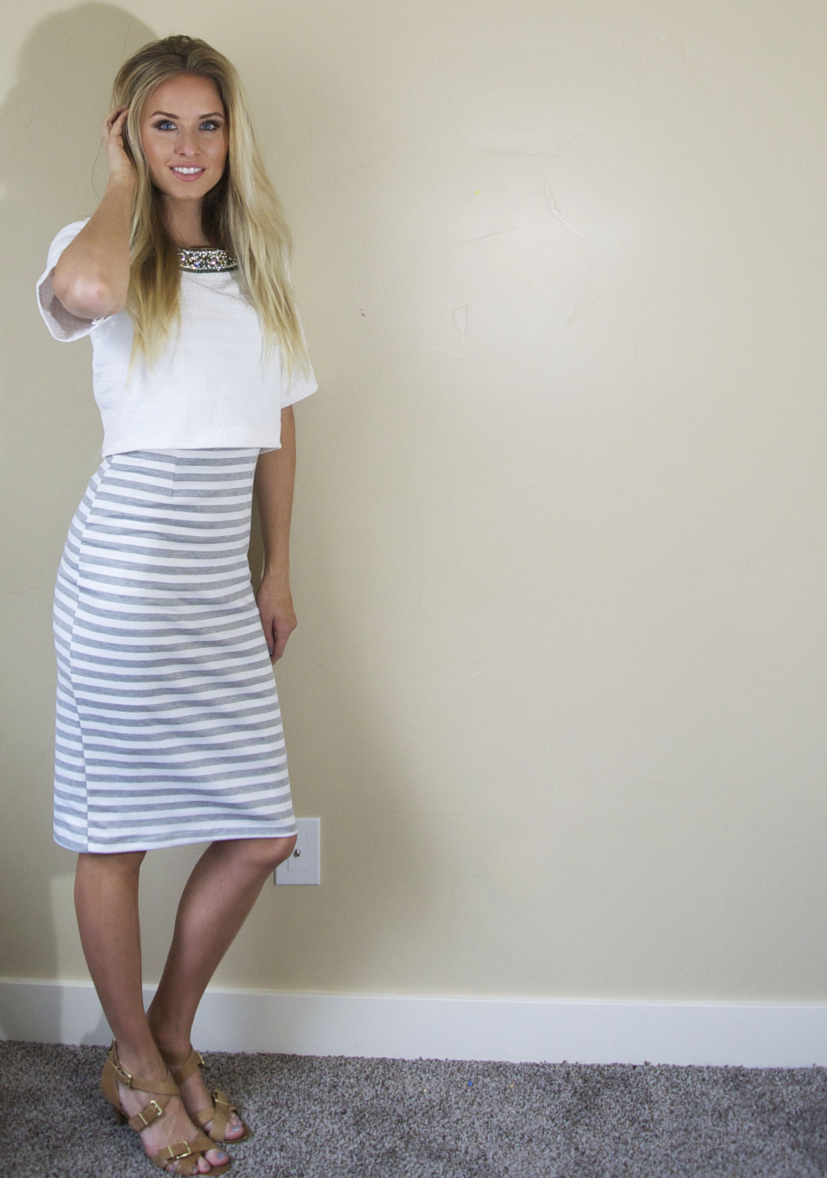 Throw a cropped top over a dress.  Get the same look without having to worry about your midriff showing.