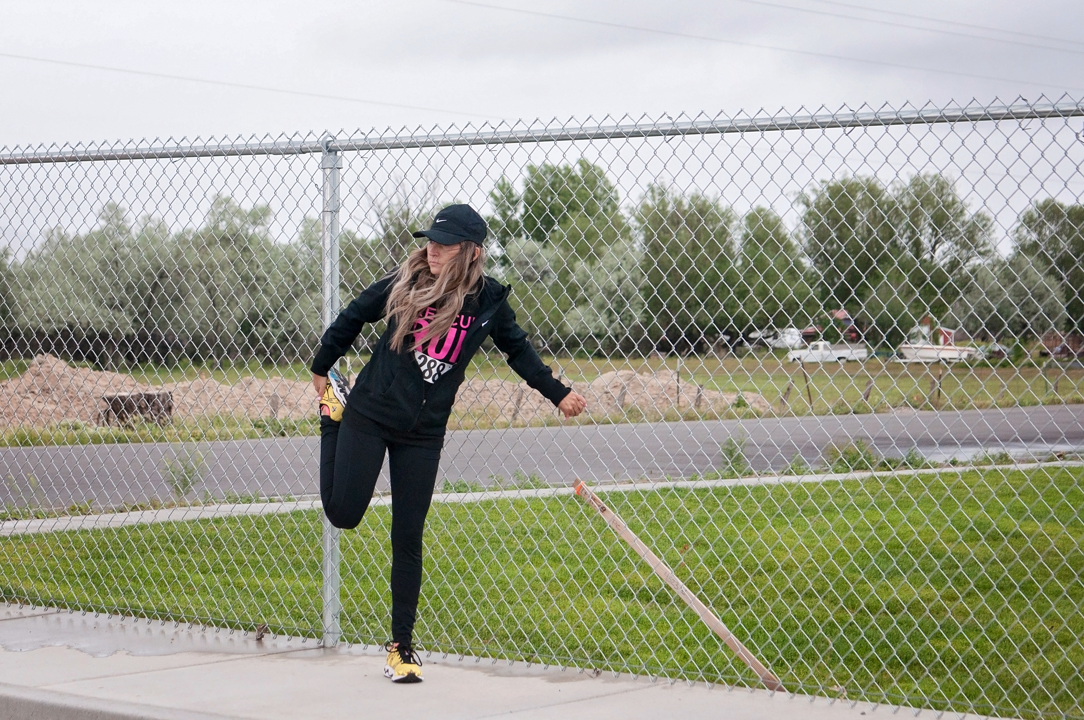 How much does it cost to throw a 5k? This race director opens up. | How Much is a 5K by popular Utah lifestyle blogger, Kara Metta: image of a woman stretching at the Rescue Run marathon.