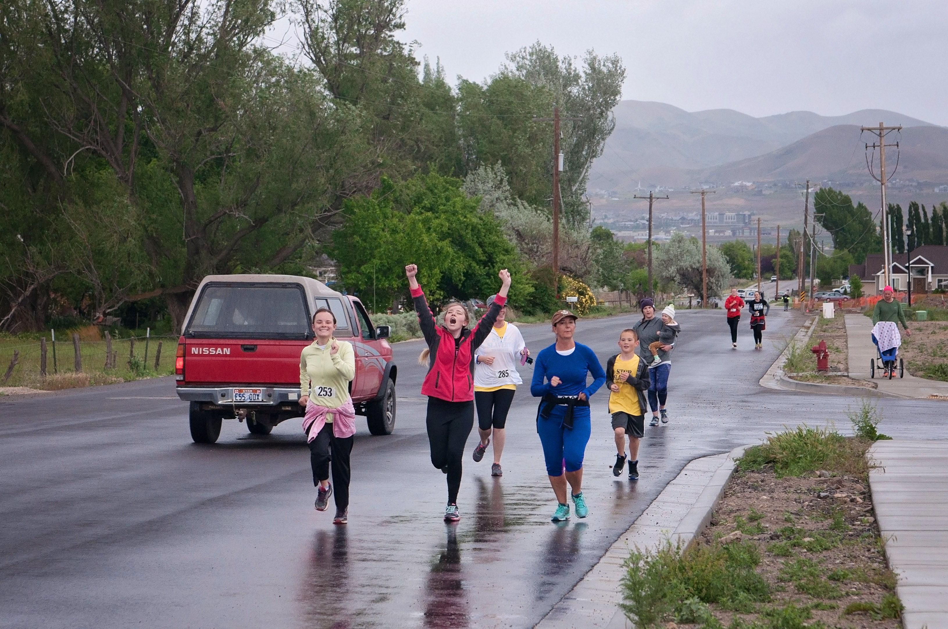 Rescue Run-63 | How Much is a 5K by popular Utah lifestyle blogger, Kara Metta: image of a group of people running in the Rescue Run marathon.