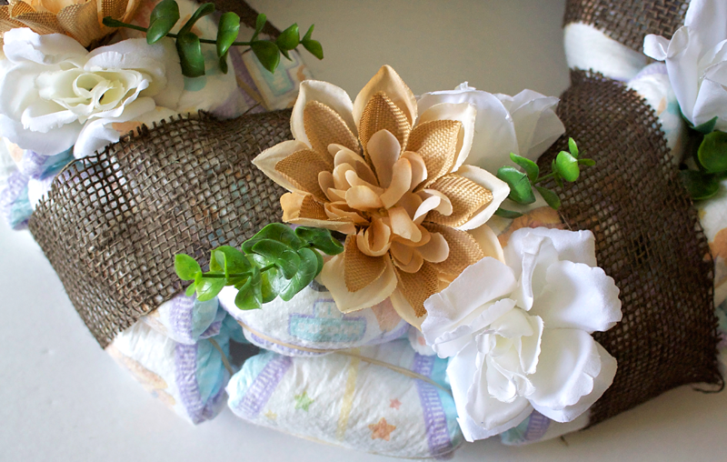 DIY Diaper baby shower gifts. #SuperAbsorbent #CollectiveBias #ad \ Creative Things to Make With Diapers by popular Utah lifestyle blogger, Kara Metta: image of a diaper wreath.