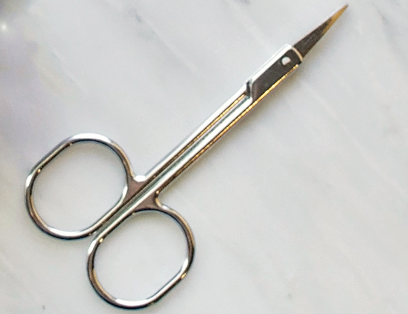 scissors | How to Wax Your Eyebrows at Home by Popular Utah beauty blogger, Kara Metta: image of cuticle scissors.