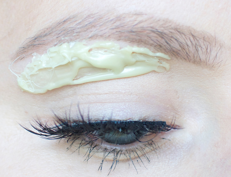 How to wax your eyebrows at home. | How to Wax Your Eyebrows at Home by Popular Utah beauty blogger, Kara Metta: image of a woman with Surgi-Wax under her eyebrows.