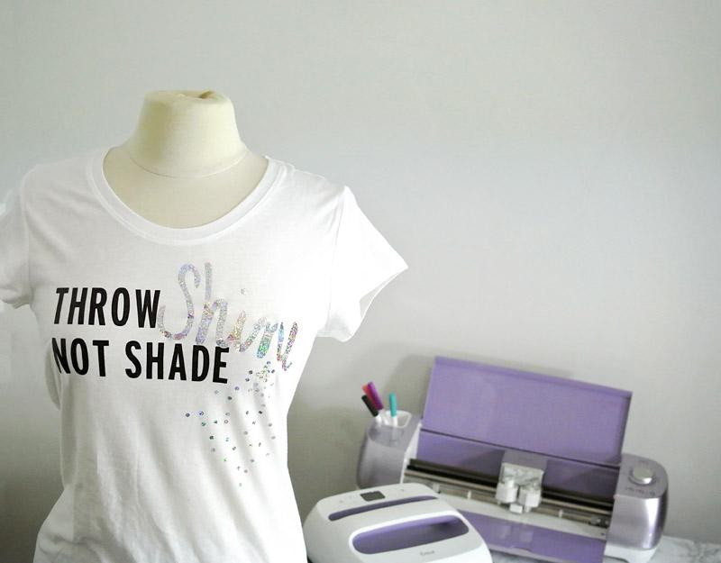 How to Use The Cricut EasyPress @JOANN #handmadewithJOANN | Cricut Easy Press by popular Utah sewing blogger, Kara Metta: image of a white diy graphic t-shirt next to a Cricut Easy Press.