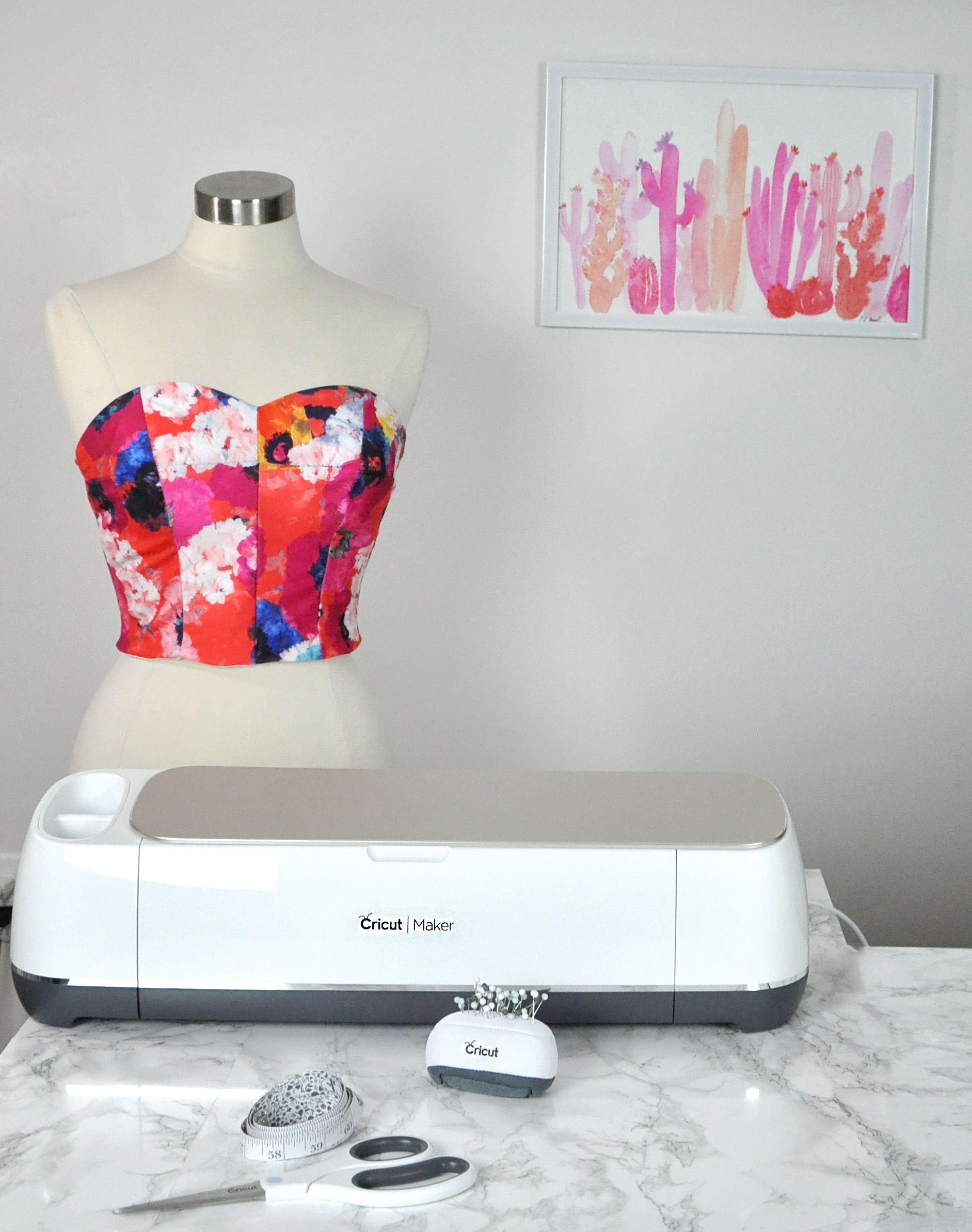 How to make a swimsuit top using the Cricut Maker and the Design Space Simplicity crop top pattern. #cricut #ad #cricutmade | DIY Swimsuit Top by popular Utah sewing blogger, Kara Metta: image of a DIY swimsuit top on a mannequin and a Cricut Maker.