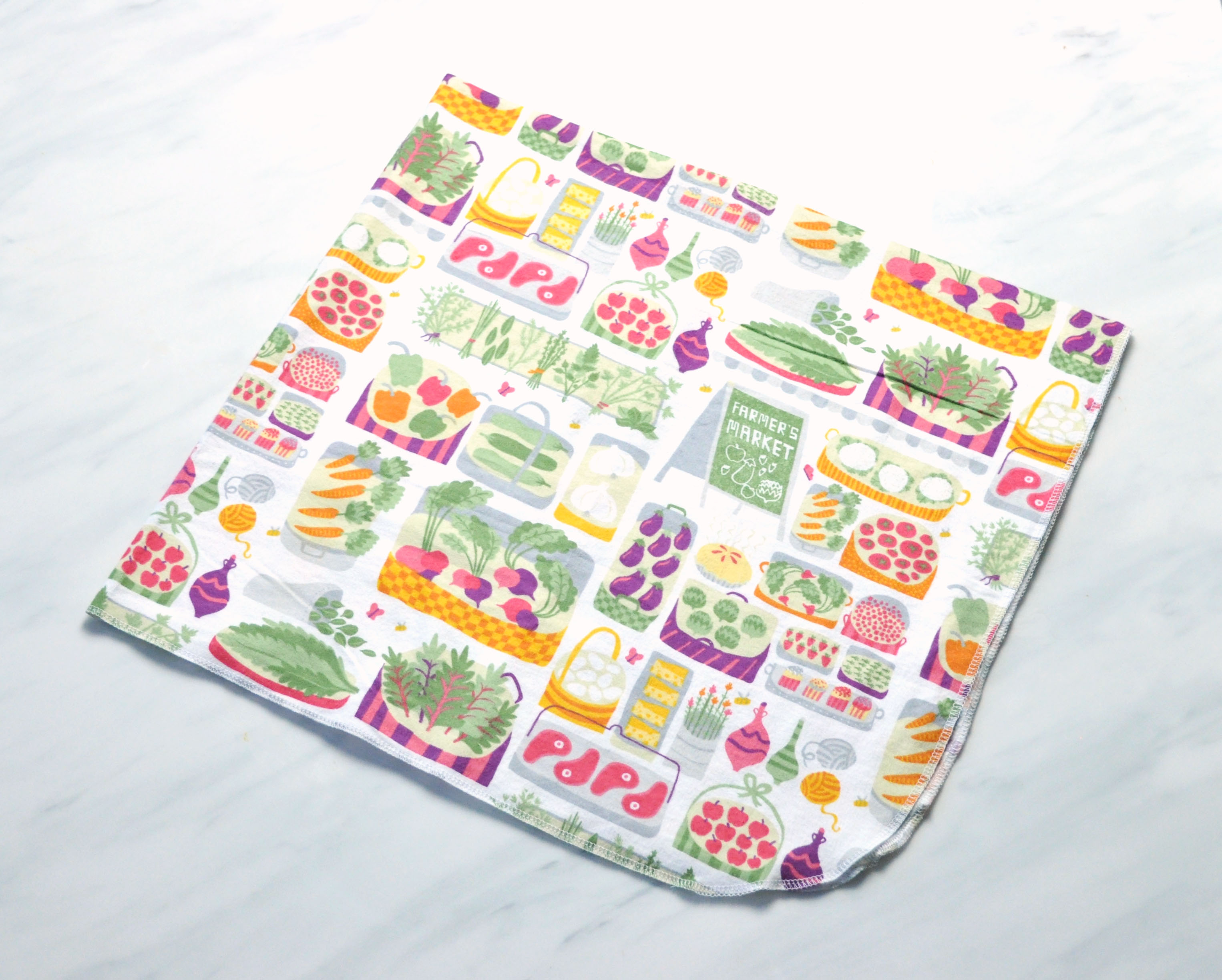 DIY Flannel Receiving Blankets sewing tutorial featured by top US sewing blogger, Kara Metta | How to sew a baby blanket using a serger.