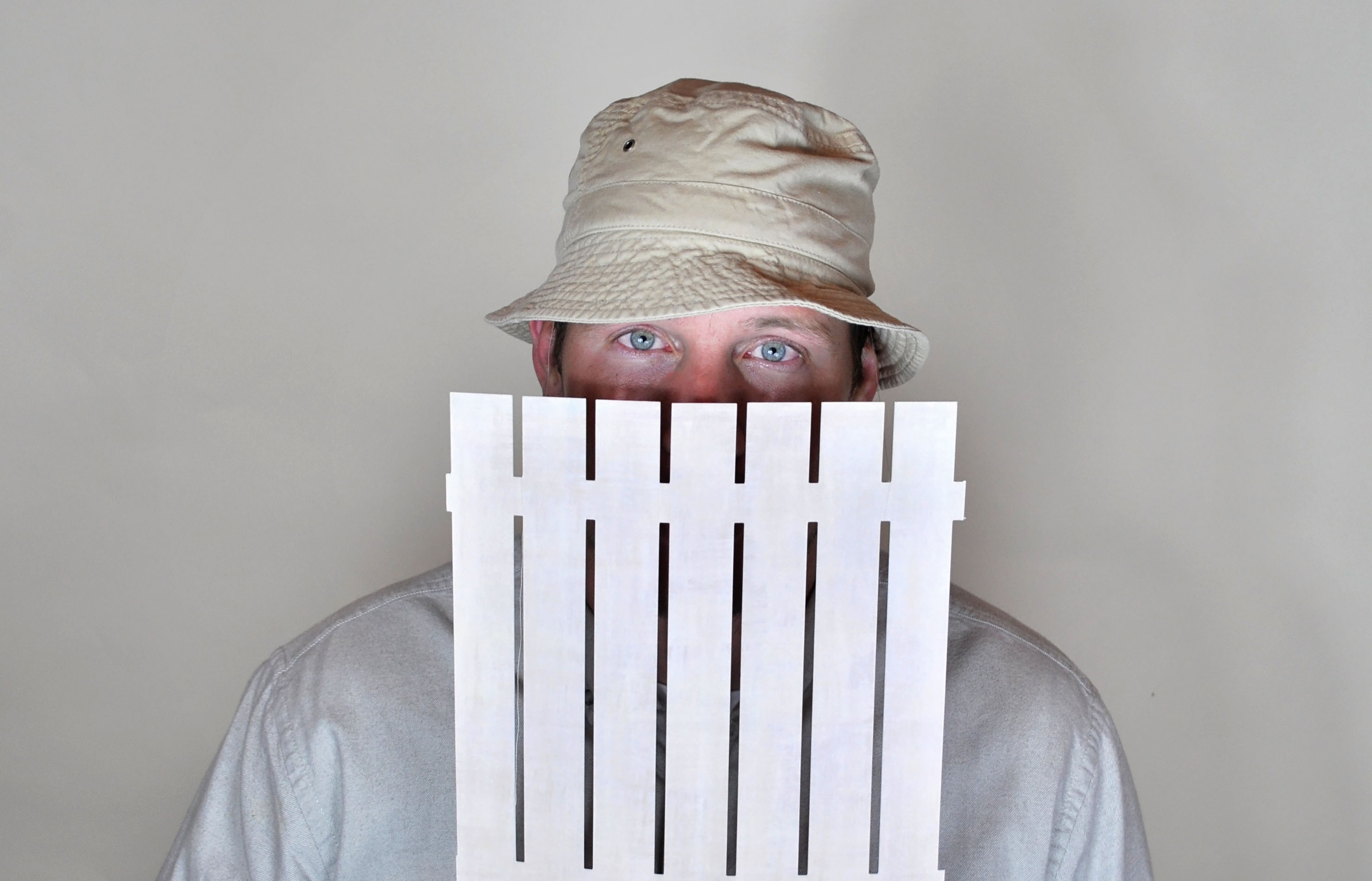 Ridiculously easy last minute halloween costume--Wilson from home improvement. Make a paper fence, attach to hat with string. Done! Heidi-ho neighbor-o.