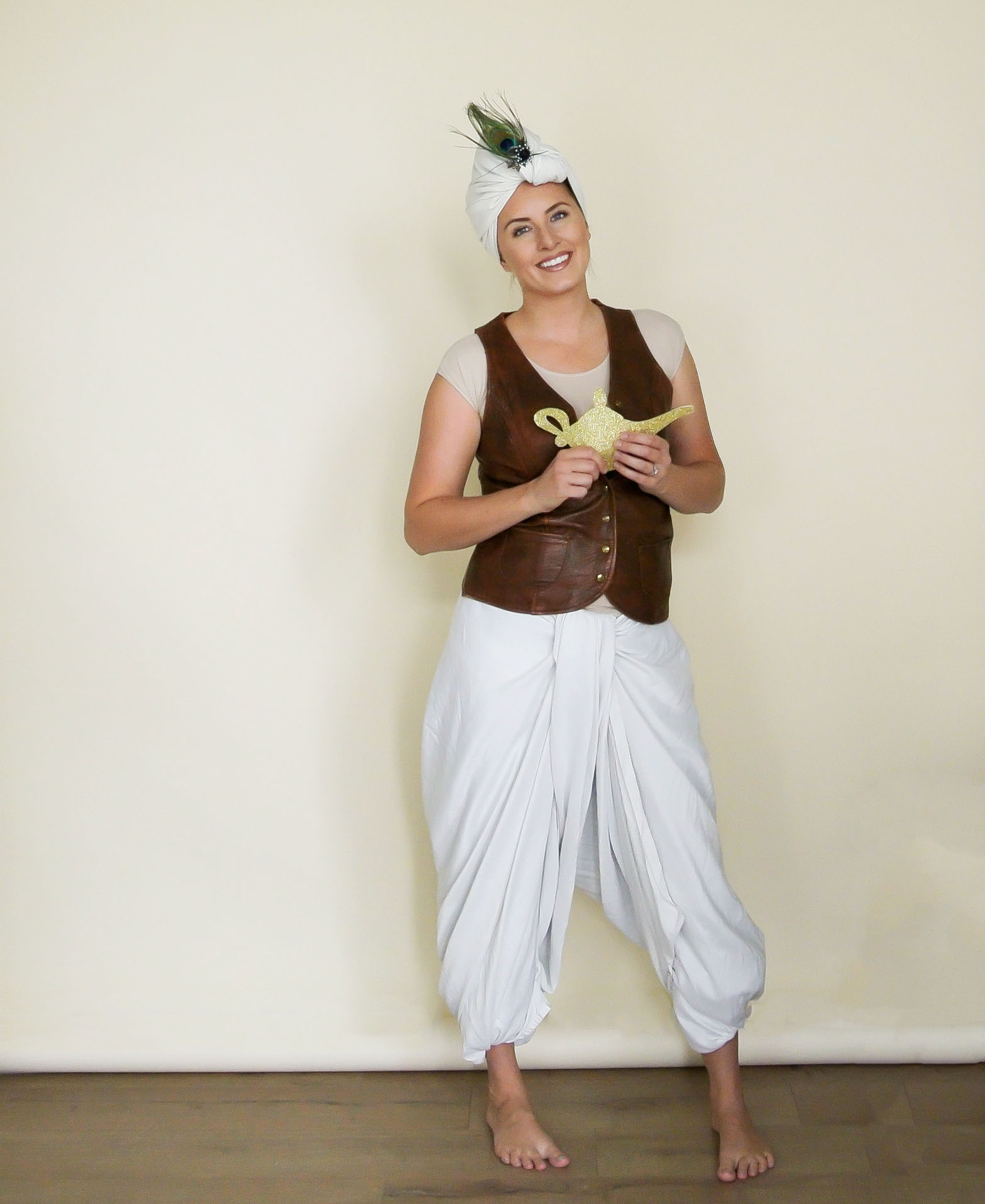 Super Creative Costumes made from sheets. The pants are made from a flat queen sheet, and the turban is a pillowcase! #diycostume #diyhalloween #homemadecostume #geniecostume