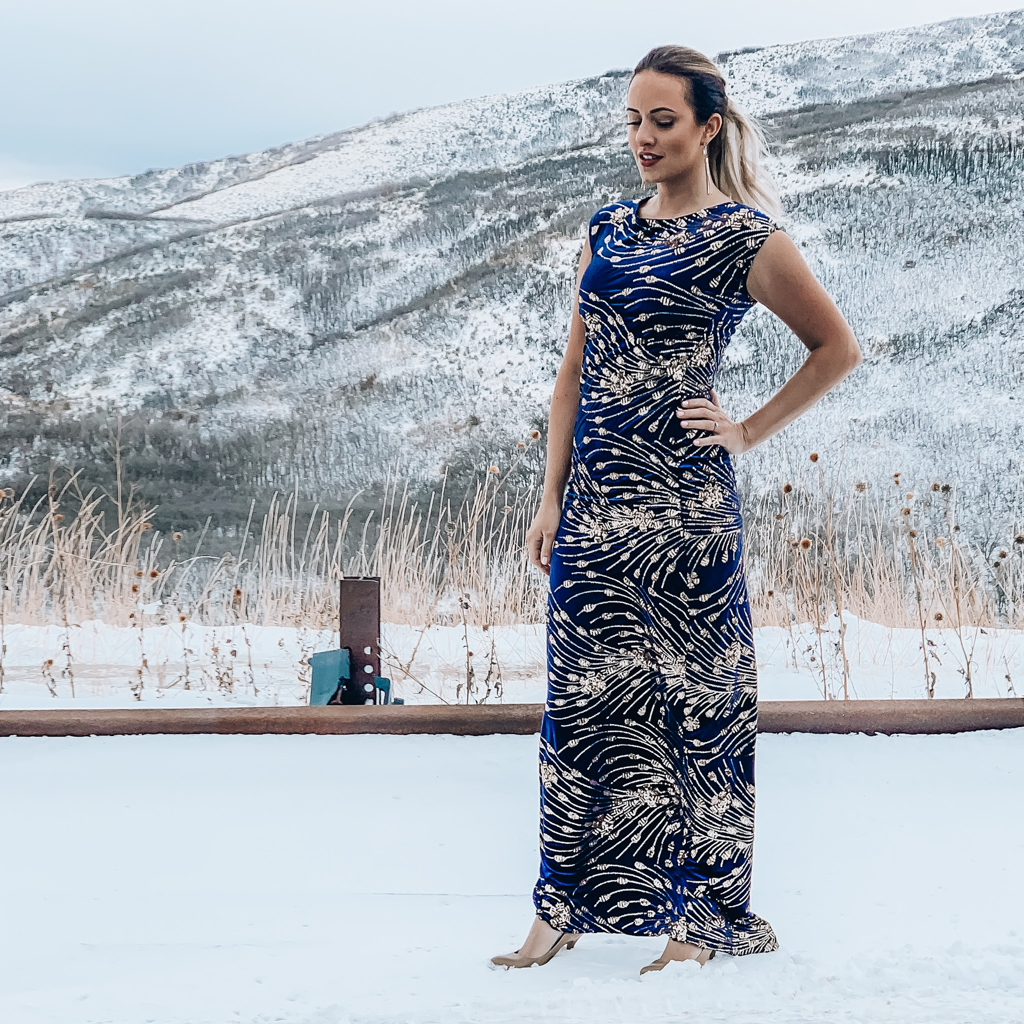 Woman wears blue and gold formal dress outside in snow.DIY Formal Dress, a sewing tutorial featured by top US sewing blogger, Kara Metta: